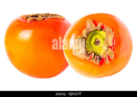 Isolated fruits. Two whole persimmon isolated on white background with clipping path as package design element; - Stock Photo