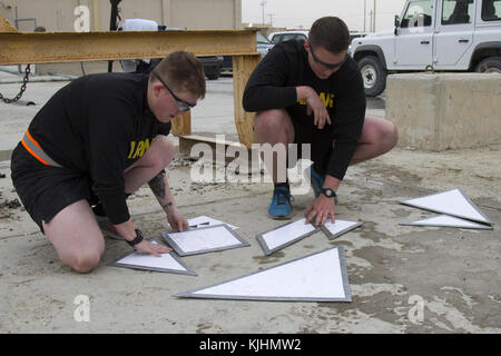 Dog-faced Solders from 3rd Infantry Division recreate two shapes as part of a mental challenge during a physical - Stock Photo
