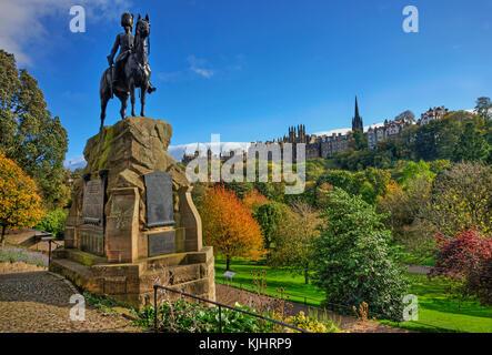 Autumn view towards a distant mound from the royal scots greys monument Princes Street gardens, Edinburgh, Lothian. - Stock Photo