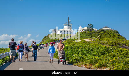 Australia, New South Wales, Newcastle, Nobby Head, visitors on their way to Nobby Lighthouse - Stock Photo