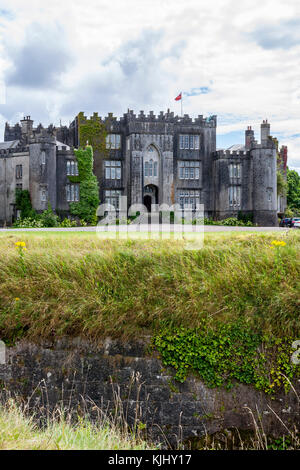 View of Birr Castle from beyond its surrounding moat, Ireland - Stock Photo