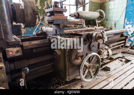 Old abandoned factory rooms, lathes - Stock Photo