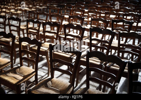 Auxerre cathedral dedicated to Saint Stephan.  Empty chairs.  France. - Stock Photo