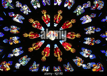 Auxerre cathedral dedicated to Saint Stephan.  Stained glass window.  Rose window.  God.  France. - Stock Photo