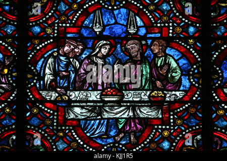 Auxerre cathedral dedicated to Saint Stephan.  Stained glass window.  Marriage at Cana.  France. - Stock Photo