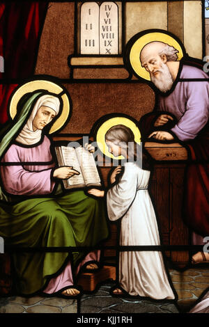 Saint Martin church.  Stained glass window. Saint Anne teaching Virgin Mary to read.  Avallon. France. - Stock Photo