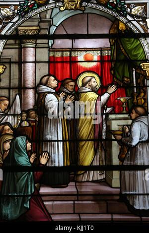 Saint Martin church.  Stained glass window.  Saint Martin of Tours.  Avallon. France. - Stock Photo