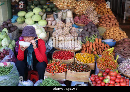 Woman selling fresh vegetables on market. Dalat. Vietnam. - Stock Photo
