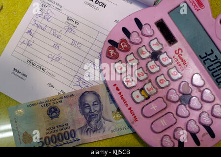 Vietnamese currency, the Dong. Bill with bank note.  Ho Chi Minh City. Vietnam. - Stock Photo
