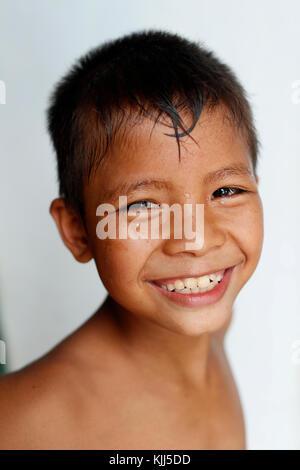Bahnar (Ba Na) ethnic group. Young boy smiling.  Kon Tum. Vietnam. - Stock Photo