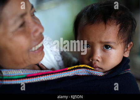 Bahnar (Ba Na) ethnic group. Mother with her son.  Kon Tum. Vietnam. - Stock Photo