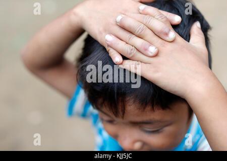 Bahnar (Ba Na) ethnic group.  Young boy. Portrait.  Kon Tum. Vietnam. - Stock Photo