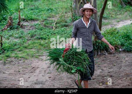 Bahnar (Ba Na) ethnic group. Farmer.  Kon Tum. Vietnam. - Stock Photo