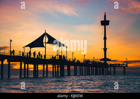 People enjoying sunset from Brighton Jetty, South Australia - Stock Photo