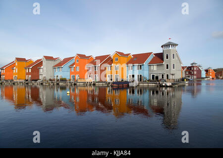 Colourful waterfront houses at the Reitdiephaven (Reitdiep Marina) in Groningen, the Netherlands. - Stock Photo
