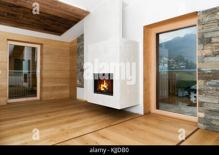 new empty living room interior with fireplace and hardwood floor - Stock Photo