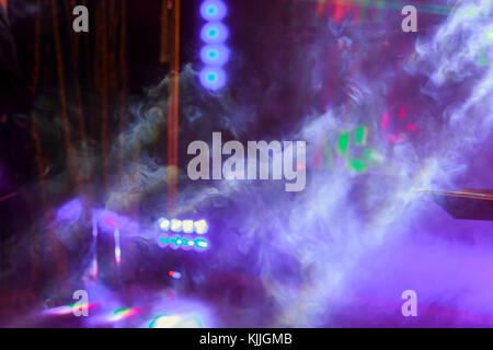 Laser Lights at Pub pink lights and smoke in club for party - Stock Photo