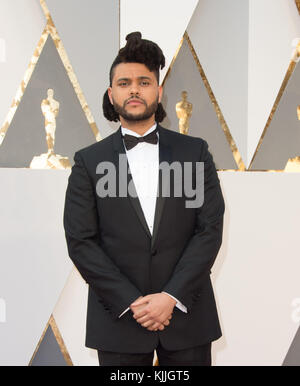 HOLLYWOOD, CA - FEBRUARY 28: The Weeknd attends the 88th Annual Academy Awards at Hollywood & Highland Center on - Stock Photo