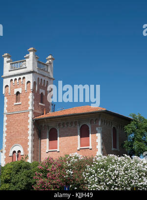 Porto Potenza Picena (Macerata, Marches, Italy): odd old house with tower and flowered garden - Stock Photo