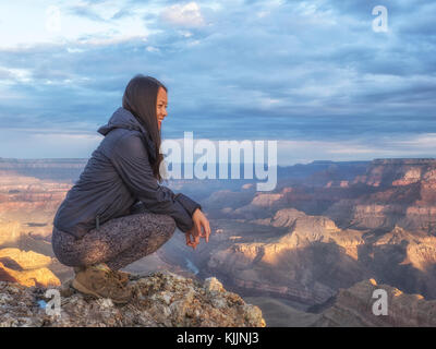 USA, Arizona, Grand Canyon National Park, tourist enjoying the view - Stock Photo