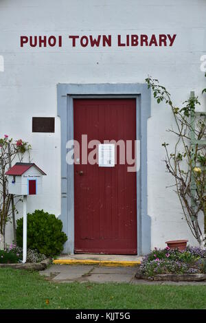 Red wooden door on tiny library building in Puhoi village near Auckland. - Stock Photo