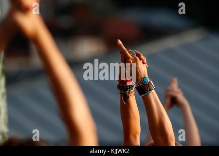 Large yoga class strecthing arms up. Close-up.  Saint-Gervais Mont-Blanc. France. - Stock Photo