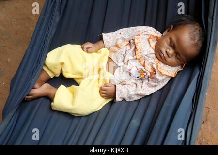 Baby sleeping in a hammock. Battambang.  Cambodia. - Stock Photo