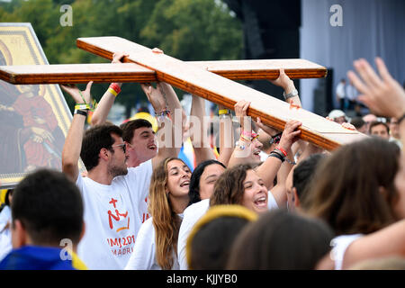 World Youth Day. Krakow. 2016. Youth carrying the WYD cross. Poland. - Stock Photo