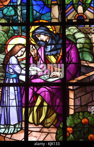 Dalat cathedral.  Stained glass window.  St Anne and the Virgin Mary. Education.  Dalat. Vietnam. - Stock Photo