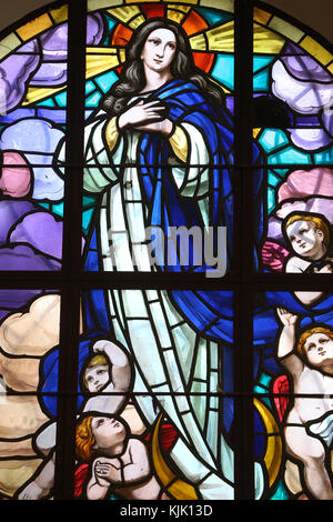 Dalat cathedral.  Stained glass window. The Assumption of Mary into Heaven. Dalat. Vietnam. - Stock Photo