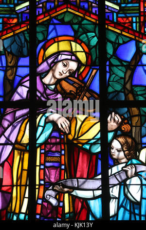 Dalat cathedral.  Stained glass window. Saint Cecilia  is the patroness of musicians. Dalat. Vietnam. - Stock Photo