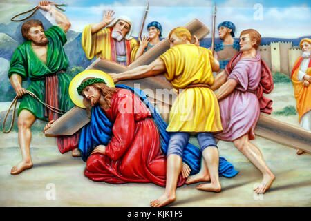 Our Lady of Fatima church.  Way of the cross.  Station 3. Jesus falls for the first time. Ho Chi Minh City.  Vietnam. - Stock Photo