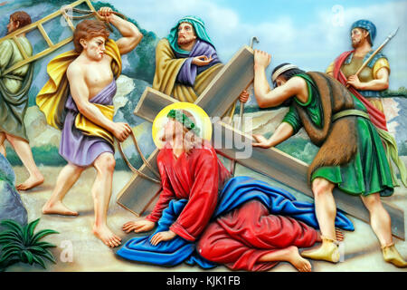 Our Lady of Fatima church.  Way of the cross.  Station 7. Jesus falls for the second time. Ho Chi Minh City.  Vietnam. - Stock Photo