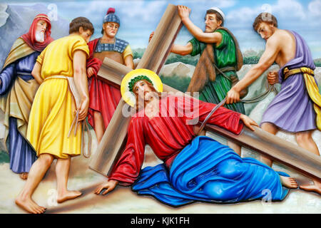 Our Lady of Fatima church.  Way of the cross.  Station 9. Jesus falls for the third time. Ho Chi Minh City.  Vietnam. - Stock Photo