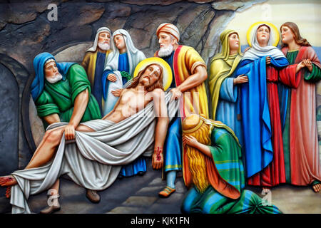 Our Lady of Fatima church.  Way of the cross.  Station 14. Jesus is placed in the tomb. Ho Chi Minh City.  Vietnam. - Stock Photo