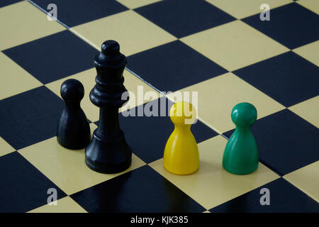 24.10.2017, Board game pieces in the Jamaican national colours on a chess board. The next German government could - Stock Photo