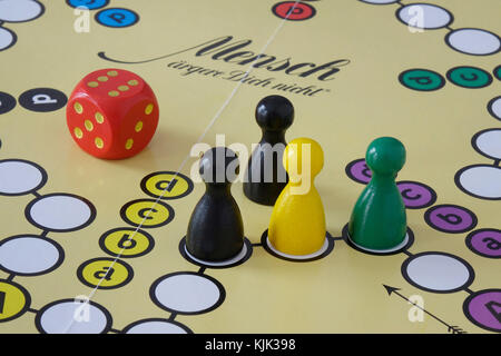 24.10.2017, Board game pieces in the Jamaican national colours on a Ludo board. The next German government could - Stock Photo