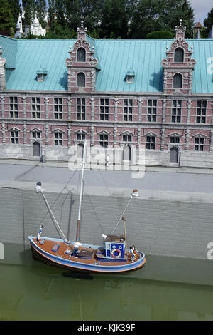 A miniature of the Stock Exchange in the Danish capital Copenhagen, with a ship on the canal in front of it, at - Stock Photo