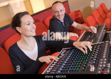 two sound producer working in the studio - Stock Photo