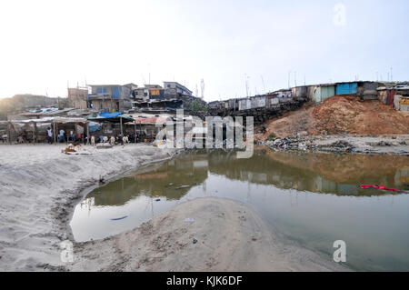 ACCRA, GHANA - MAY 1, 2012: Polluted slum on the beach in Accra, Ghana. - Stock Photo