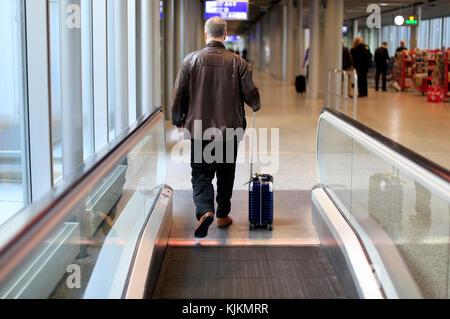 Geneva airport.  Passanger. Switzerland. - Stock Photo