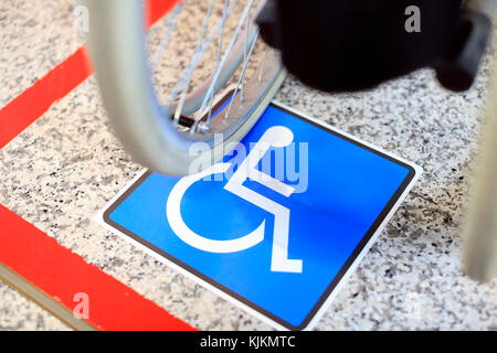 Geneva airport. Disabled parking space and wheelchair.  Switzerland. - Stock Photo