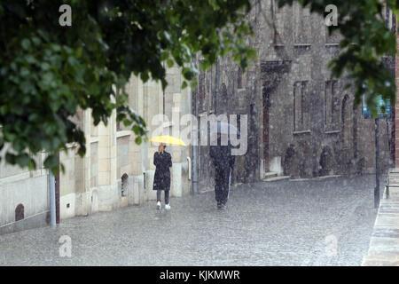 Rainy day. Couple walking under umbrella.  Geneva. Switzerland. - Stock Photo