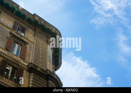 A view of an Italian building from below with the sky above; picture taken at Rome, Italy. - Stock Photo