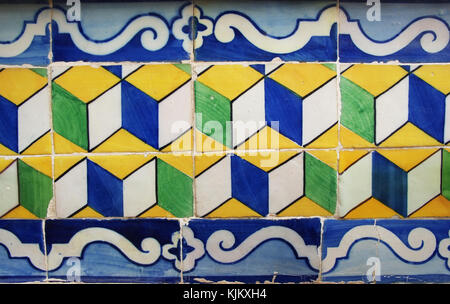 Blue, yellow and green Portuguese tiles (azulejos) with geometric pattern - Stock Photo
