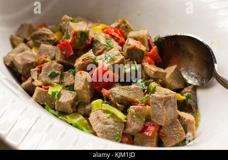 Salad with pieces of beef with vegetables under the sauce - Stock Photo