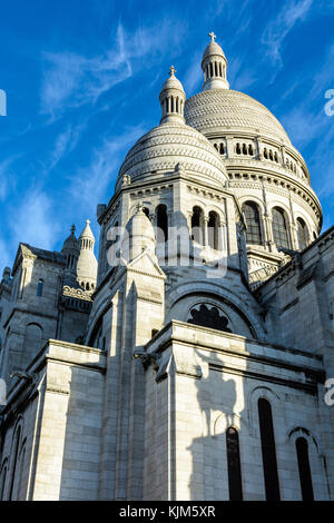 Three-quarters front view from below of the dome of the Basilica of the Sacred Heart of Paris with the shadow of - Stock Photo