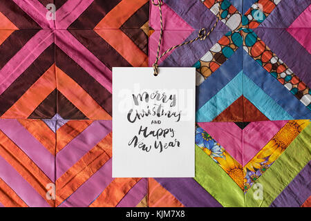 winter, holidays, hancraft concept. lovely present for christmas, it is amazing blanket made of patches in all coloures - Stock Photo