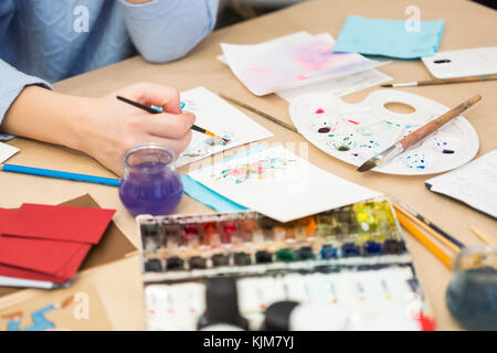 creating, art, art job concept. work place of female artist, she is drawing flowers on small pieces of sheets with - Stock Photo