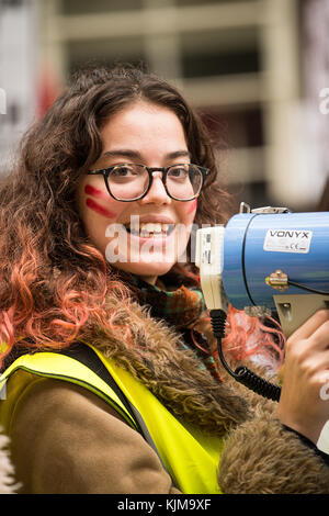 Smiling student with megaphone at the protest demo for the Campaign Against Education Fees and Cuts, through the - Stock Photo